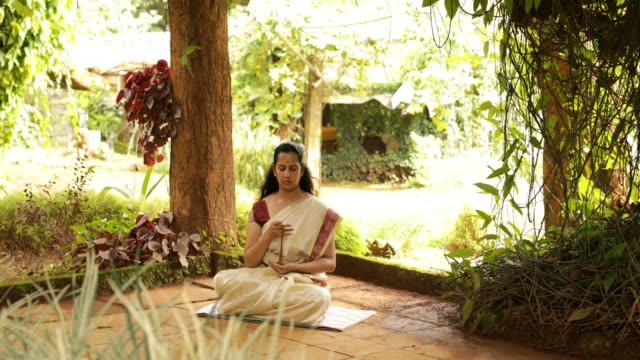 hindu woman in deep meditation - religion stock videos & royalty-free footage