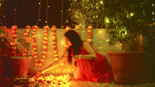 hindu woman lighting diyas - oil lamp stock videos & royalty-free footage