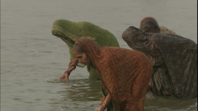 Hindu women cleansing and purifying themselves in Ganges, Uttar Pradesh, India