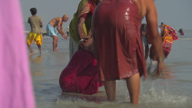 Hindus bathe themselves in the holy waters of the Ganges at Sagar Island.