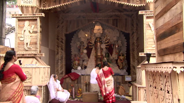 Hindus worship at a pandal during the Durga Puja festival. Available in HD.