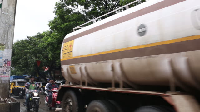 a hindustan petroleum corp gas station and tanker carry fuel near bharat petroleum corp refinery in mumbai india on thursday june 28 2018 - maharashtra stock-videos und b-roll-filmmaterial