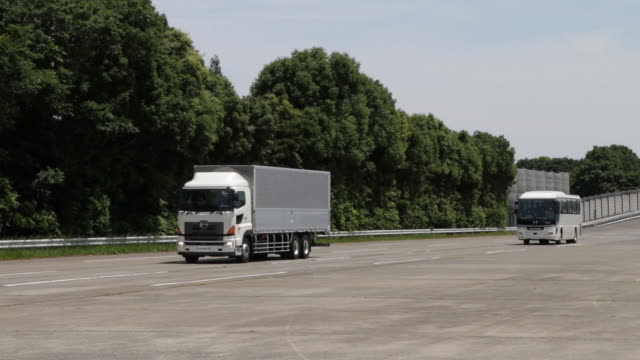 hino motors ltd buses and trucks travel along a road during a demonstration for the company's automated driving technology at a test course in hamura... - autonomous technology stock videos & royalty-free footage
