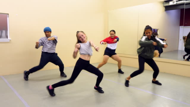 ms hip hop dance group dancing together in studio during practice - dance studio stock-videos und b-roll-filmmaterial
