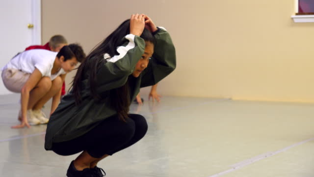 r/f hip hop dance group stretching in dance studio before practice - dance studio stock videos & royalty-free footage