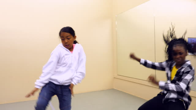 pan hip hop dance students dancing together during dance class - athleticism stock videos & royalty-free footage