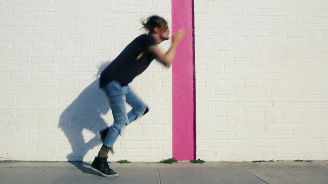 hip man in torn jeans dancing like a dolphin - hüfte stock-videos und b-roll-filmmaterial