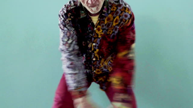 hip senior gay man dancing - colored background stock videos & royalty-free footage