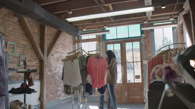 hip young couple walk into downtown clothing shop on sunny day. - wilmington north carolina stock videos & royalty-free footage