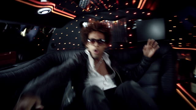 hip-hop star dances wildly for camera in back of limousine at awards show - music video stock videos and b-roll footage