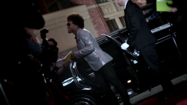 hip-hop star signs autographs and dances across red carpet at awards show - autographing stock videos & royalty-free footage