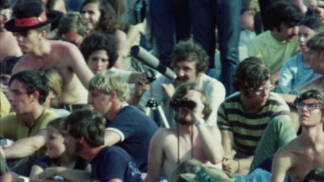 ms hippie audience at woodstock festival / bethel, new york, usa - 1969 stock-videos und b-roll-filmmaterial