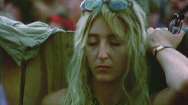 cu pan selective focus hippie audience at woodstock festival / bethel, new york, usa - warner bros stock videos and b-roll footage
