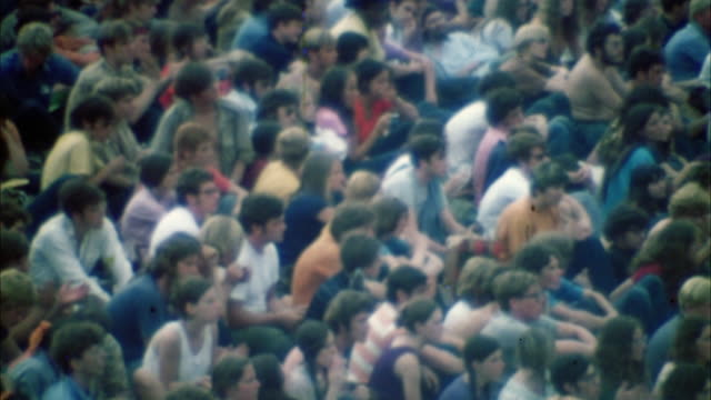ws ha swish pan hippie audience at woodstock festival / bethel, new york, usa - 1969 stock videos & royalty-free footage