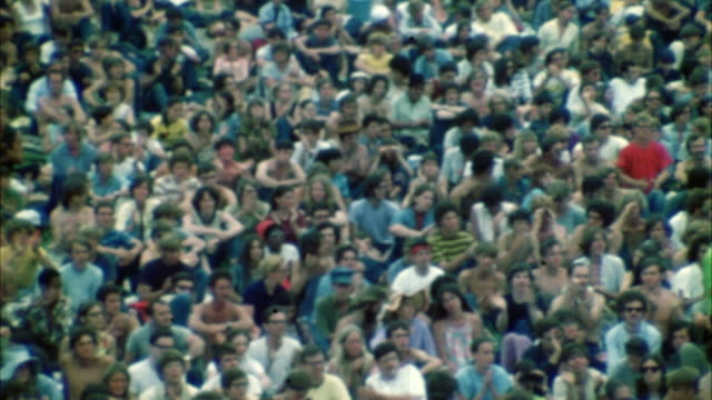 montage hippie audience at woodstock festival / bethel, new york, usa - 1969 stock-videos und b-roll-filmmaterial
