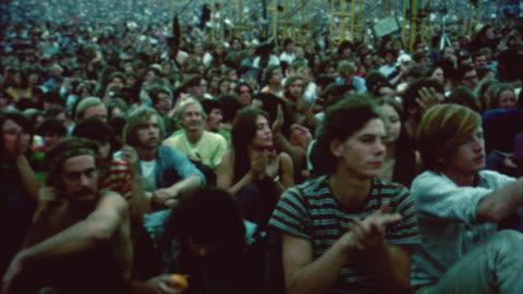 stockvideo's en b-roll-footage met montage hippie audience at woodstock festival / bethel, new york, usa - hippie