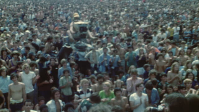 vídeos y material grabado en eventos de stock de montage hippie audience at woodstock festival / bethel, new york, usa - 1969