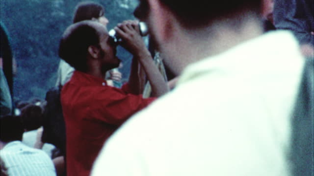 ms td hippie audience at woodstock festival / bethel, new york, usa - 1969 stock-videos und b-roll-filmmaterial