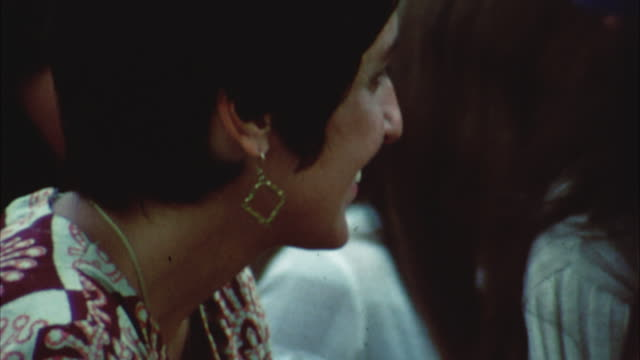 montage hippie audience with john sebastian and joan baez at woodstock festival, joe cocker on stage / bethel, new york, usa - 1969年点の映像素材/bロール