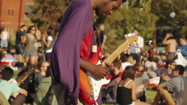 hippie band plays music in dolores park, san francisco usa - bass guitar stock videos & royalty-free footage
