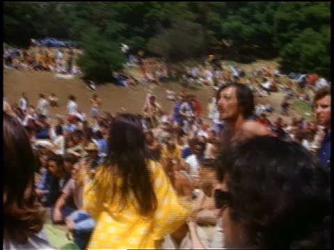 vídeos de stock e filmes b-roll de 1968 hippie couple dancing in crowded field / tapia park california / newsreel - love in
