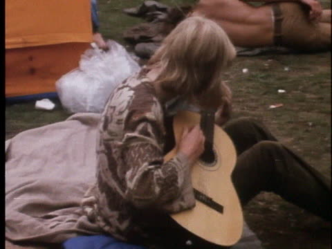 hippie plays a guitar in amsterdam's peoples park. - music or celebrities or fashion or film industry or film premiere or youth culture or novelty item or vacations stock videos & royalty-free footage
