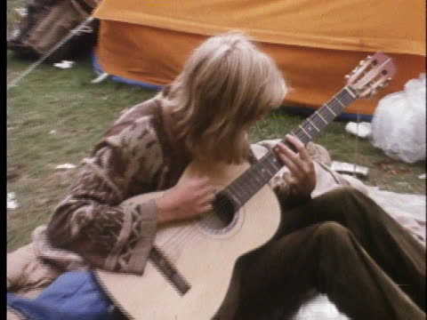 hippie plays the guitar in amsterdam's peoples park. - music or celebrities or fashion or film industry or film premiere or youth culture or novelty item or vacations stock videos & royalty-free footage