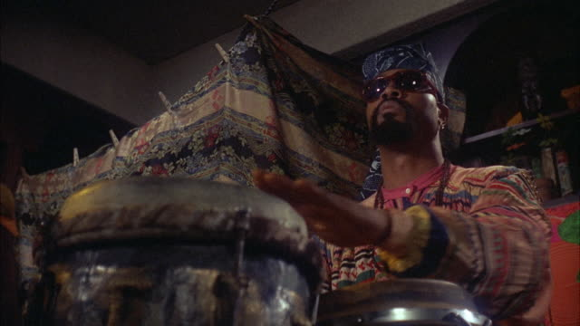MS Hippie rapping on bongo drums