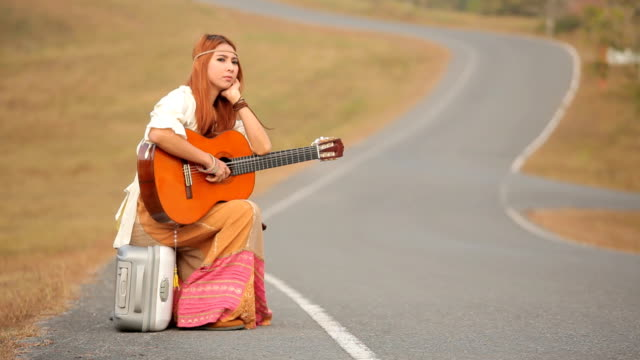hippie woman on a countryside road - waiting stock videos & royalty-free footage