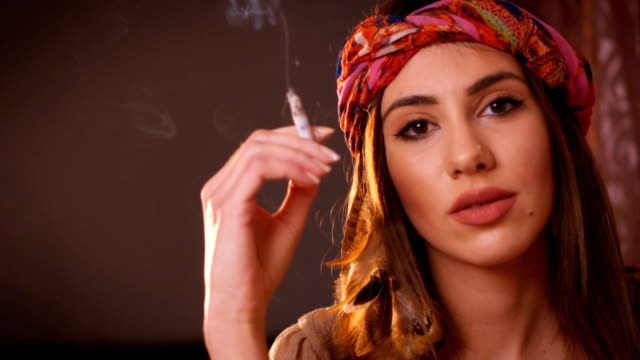 hippie woman smoking cigarette - smoking issues stock videos and b-roll footage