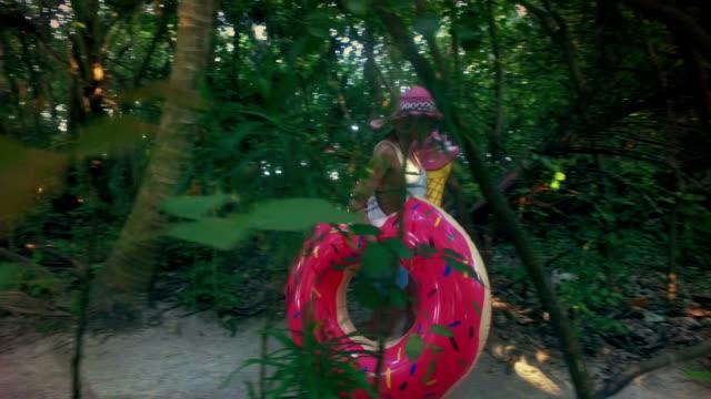 Hippie woman walking through joungle, Maldives