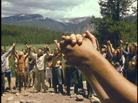 hippies at a utah commune raise their arms together. - hippie stock videos & royalty-free footage