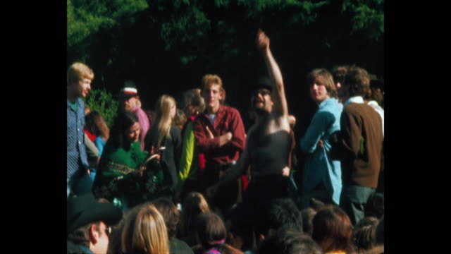 vidéos et rushes de hippies dance at a human be in at the polo fields in golden gate park during the summer of love - 1967