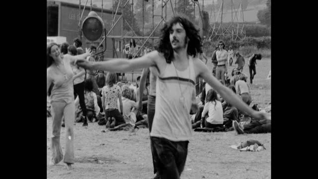 hippies dancing at 1971 glastonbury festival at worthy farm, pilton, somerset - hippy stock videos & royalty-free footage