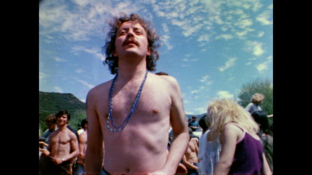 vídeos de stock e filmes b-roll de / hippies dancing at tapia park lovein / band plays on stage / cu guitar player hippies dancing at tapia park lovein on april 14 1968 in calabasas... - hippie