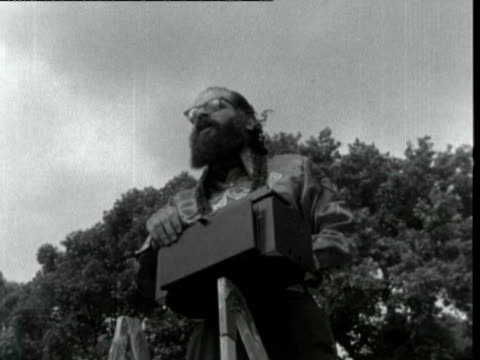 hippies hold rally in hyde park beat poet allen ginsberg playing squeezebox and chanting mantra 'hari om namah shivaya interview with man and women... - hyde park london stock videos & royalty-free footage