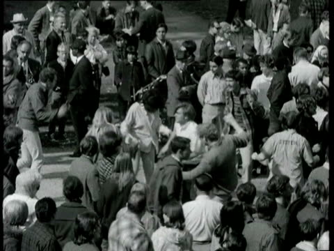 hippies in haight ashbury dancing and listening to the grateful dead band on temporary outdoor stage in panhandle park / hippie smoking pot hippies... - haight ashbury stock videos & royalty-free footage