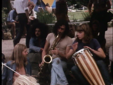 hippies listen to and play music in amsterdam's peoples park. - music or celebrities or fashion or film industry or film premiere or youth culture or novelty item or vacations stock videos & royalty-free footage