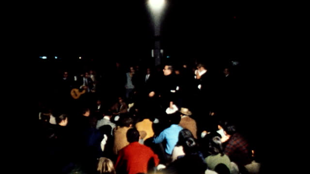 / hippies on nighttime streets in chicago during the democratic national convention / man walking on crutches / clergyman talking to hippies in... - frieden stock-videos und b-roll-filmmaterial