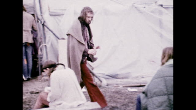 hippies waking up after a music festival; 1972 - brushing teeth stock videos & royalty-free footage