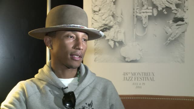 us hippop and rb star pharrell williams whose mega hit happy has already got the planet dancing speaks to afp shortly before taking the stage as the... - montreux stock videos and b-roll footage