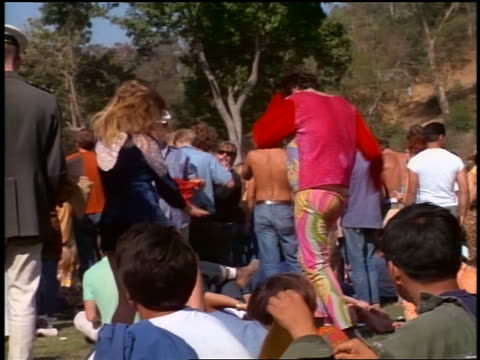 1968 hippy couple dancing at outdoor concert - hippie stock-videos und b-roll-filmmaterial