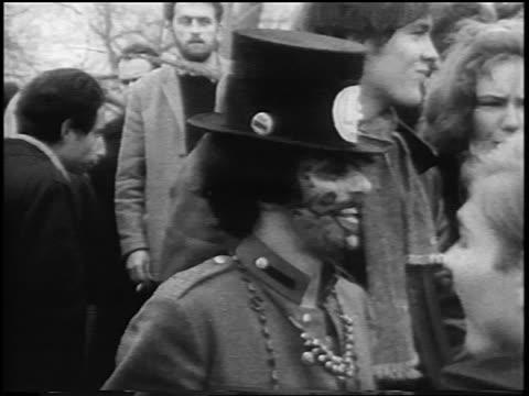 b/w 1967 hippy dancing at antiwar demonstration in central park / new york city / newsreel - manifestante video stock e b–roll