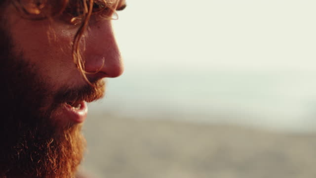 hipster bearded man slow motion portrait - sunbathing stock videos & royalty-free footage