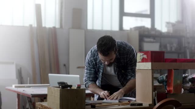 hipster carpenter at workshop - beard stock videos & royalty-free footage