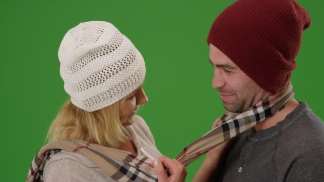 vídeos de stock, filmes e b-roll de hipster couple being affectionate in winter clothing on green screen - neckwear