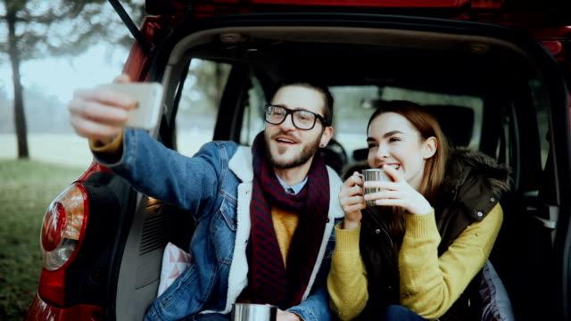 Hipster couple making selfie for social media