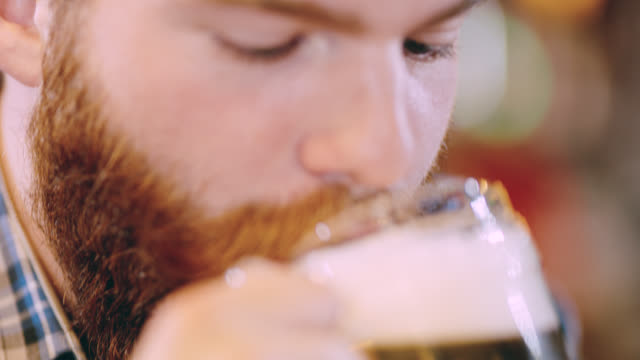 ecu hipster drinking a beer in the pub - moustache stock videos & royalty-free footage