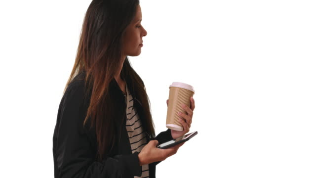 Hipster girl in bomber jacket with coffee text messaging on white background