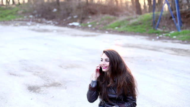 hipster girl talking on the phone outside - skateboard park stock videos & royalty-free footage